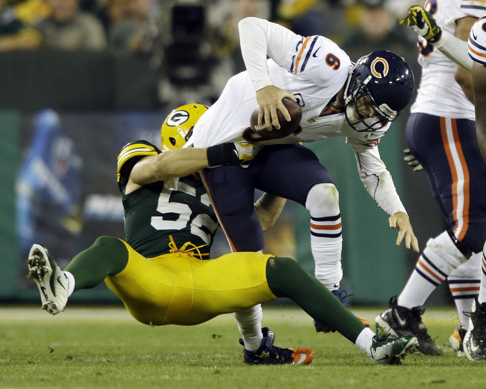 Photo -   Green Bay Packers' Clay Matthews (52) sacks Chicago Bears' Jay Cutler (6) during the second half of an NFL football game Thursday, Sept. 13, 2012, in Green Bay, Wis. (AP Photo/Jeffrey Phelps)