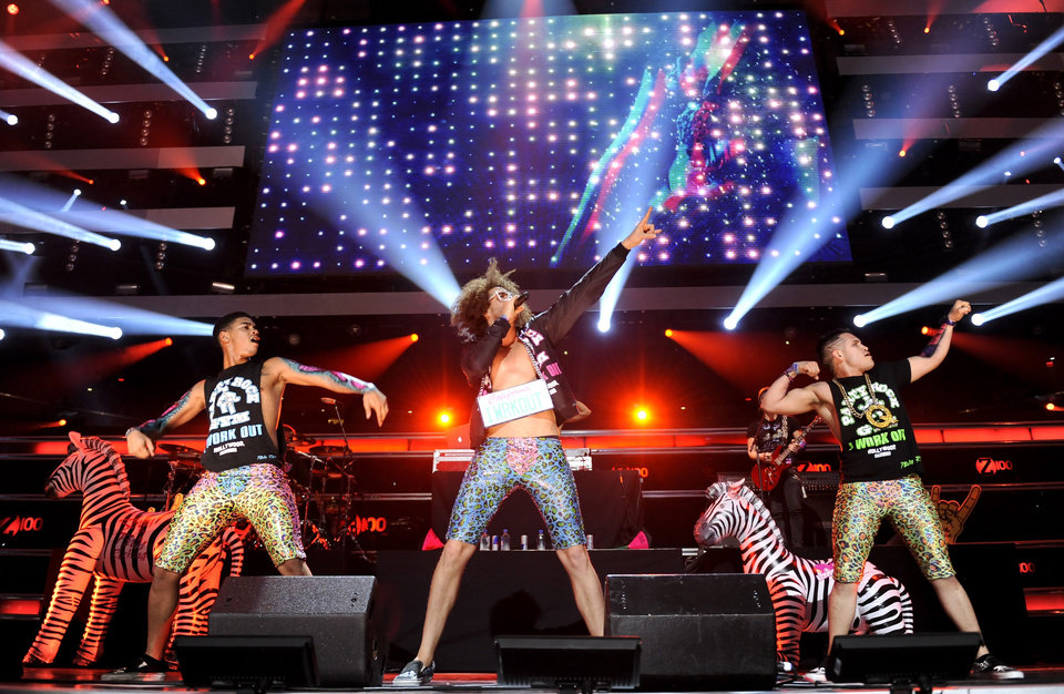 FILE- In this Friday, Dec. 9, 2011 file photo shows singer RedFoo, center, and LMFAO as they perform at Z100's Jingle Ball concert at Madison Square Garden in New York. (AP Photo/Evan Agostini, File)