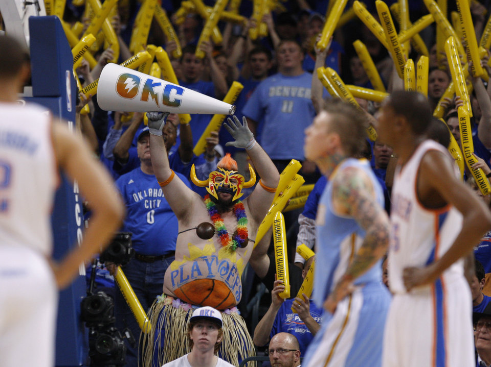 Photo - Thunder fans cheer during the NBA basketball game between the Denver Nuggets and the Oklahoma City Thunder in the first round of the NBA playoffs at the Oklahoma City Arena, Sunday, April 17, 2011. Photo by Bryan Terry, The Oklahoman