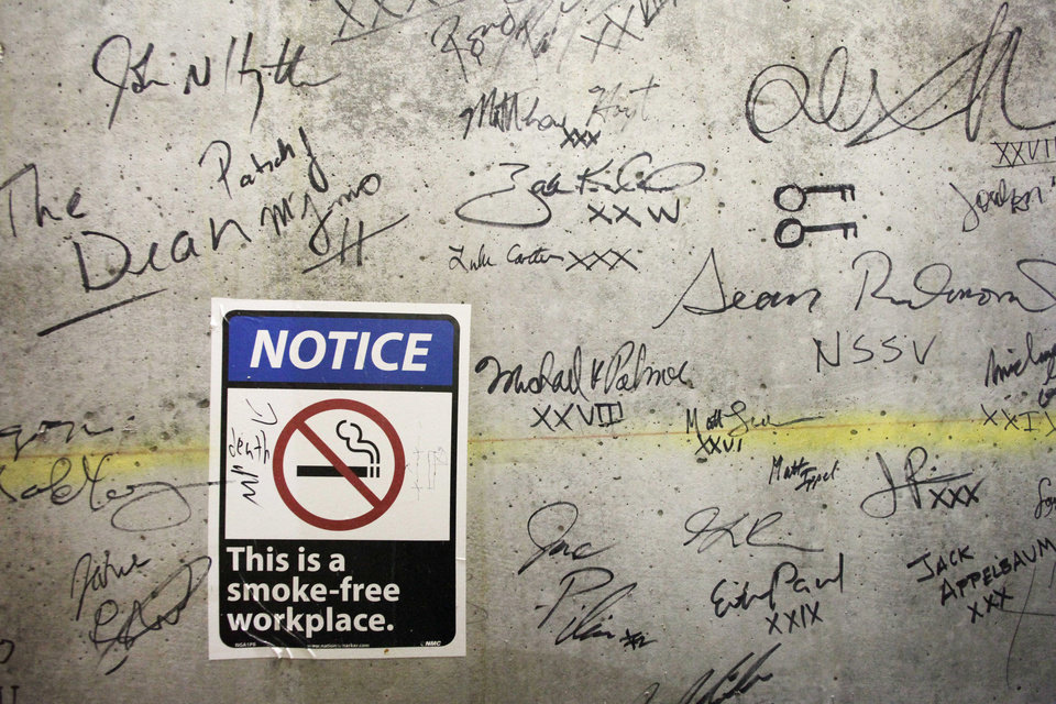 Photo - In this Jan. 15, 2013 photo, autographs cover a wall on a top floor of One World Trade Center in New York. Construction workers finishing New York's tallest building at the World Trade Center are leaving their personal marks on the concrete and steel in the form of graffiti. (AP Photo/Mark Lennihan)