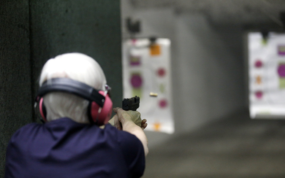 Photo -  Vondilee McCurdy shoots during a women's shooting gun club meeting at the H&H Shooting Sports Complex in Oklahoma City on Tuesday. The A Girls & A Gun club is a women's only shooting league that organized in Texas and now has chapters around the country.    SARAH PHIPPS -  NewsOK
