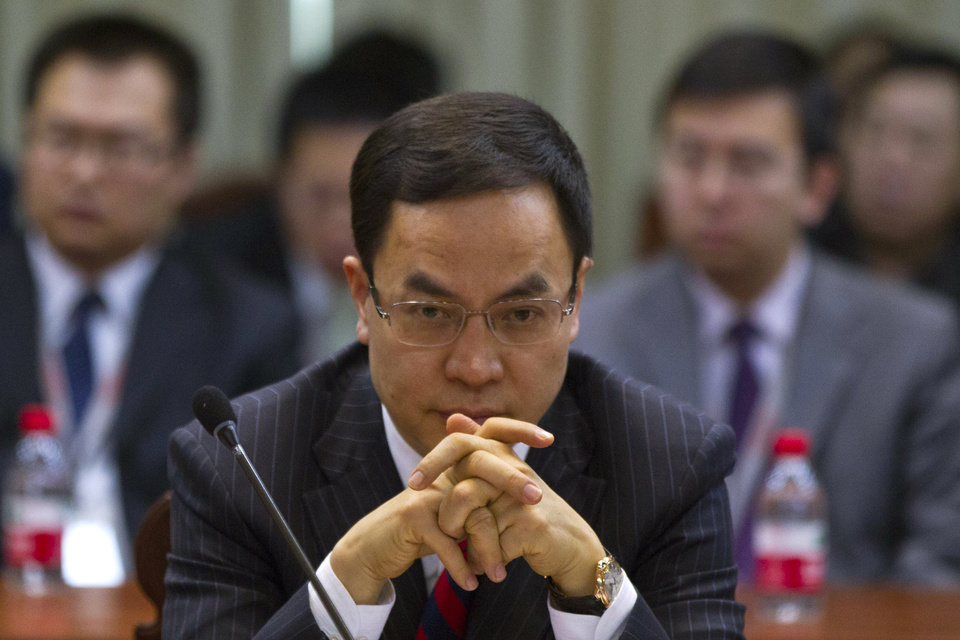 Photo - Li Hejun, chairman and CEO of Hanergy Group, attends a press conference held at the company's headquarters in Beijing, China, Wednesday, Jan. 9, 2013. The Chinese company that bought Miasole, a California producer of thin-film solar panels, says it can make a success of the emerging technology where others have suffered huge losses. (AP Photo/Alexander F. Yuan)