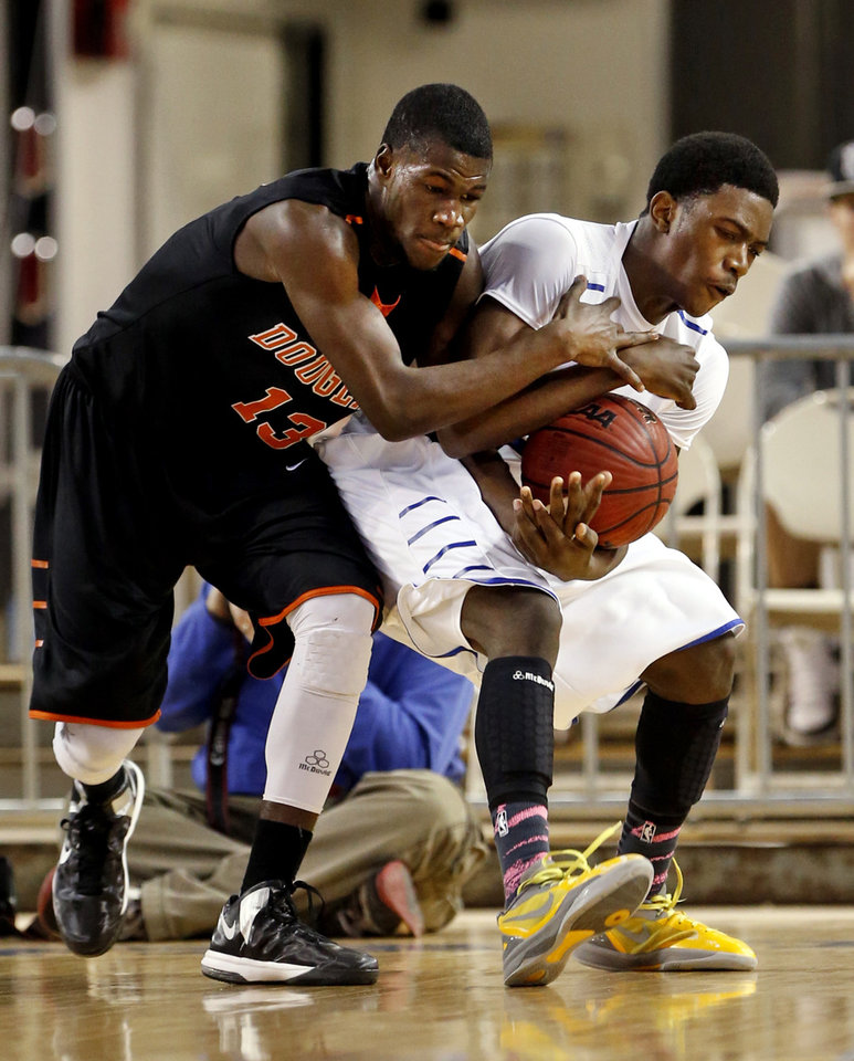 CLASS 4A HIGH SCHOOL BASKETBALL / STATE TOURNAMENT: Douglass' Glenn Banks, left, and Chris Crawford fight for the ball during the 4A boys semifinal game between the Douglass High School Trojans and Victory Christian's Conquerors at the State Fair Arena on Friday, March 8, 2013 in Oklahoma City, Okla.  Photo by Steve Sisney, The Oklahoman