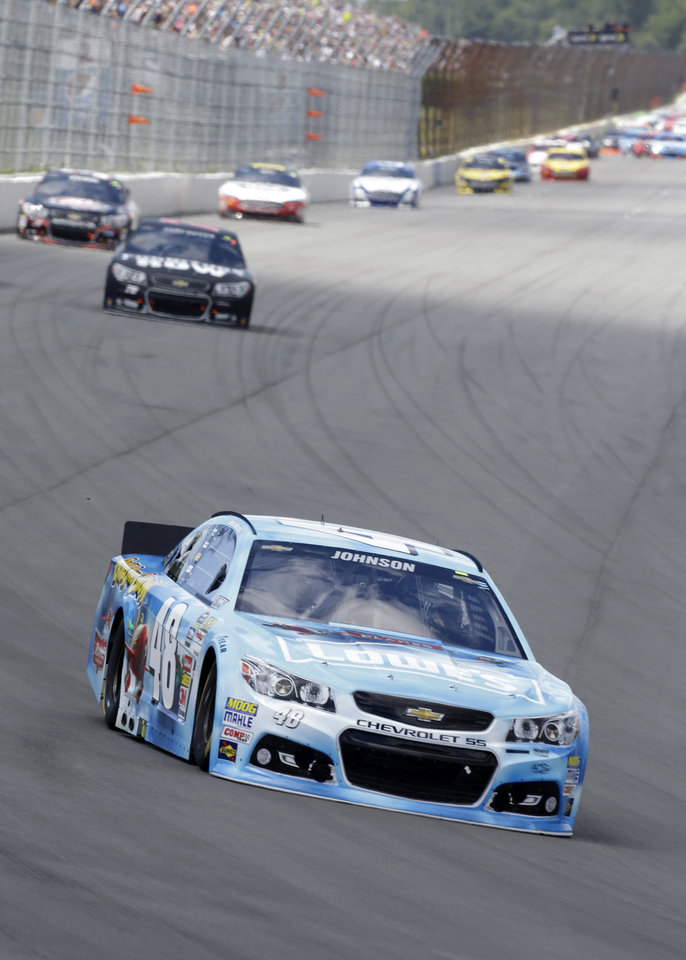 Photo - Driver Jimmie Johnson (48) leads the early laps  of an NASCAR Sprint Cup Series auto race, Sunday Aug. 4, 2013, at Pocono Raceway in Long Pond, Pa. (AP Photo/Mel Evans)