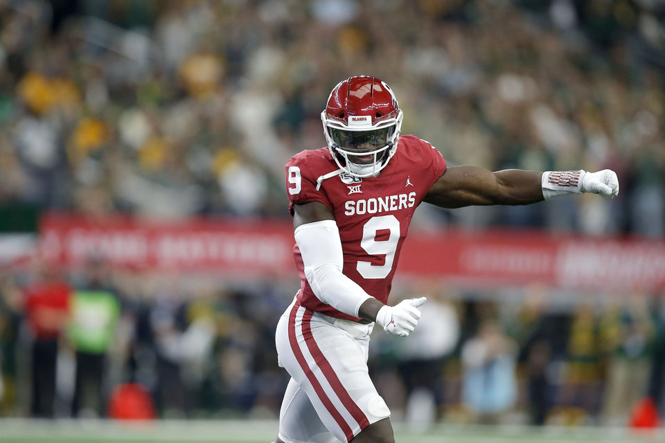 Photo - Oklahoma's Kenneth Murray (9) celebrate during the Big 12 Championship Game between the University of Oklahoma Sooners (OU) and the Baylor University Bears at AT&T Stadium in Arlington, Texas, Saturday, Dec. 7, 2019. Oklahoma won 30-23. [Bryan Terry/The Oklahoman]