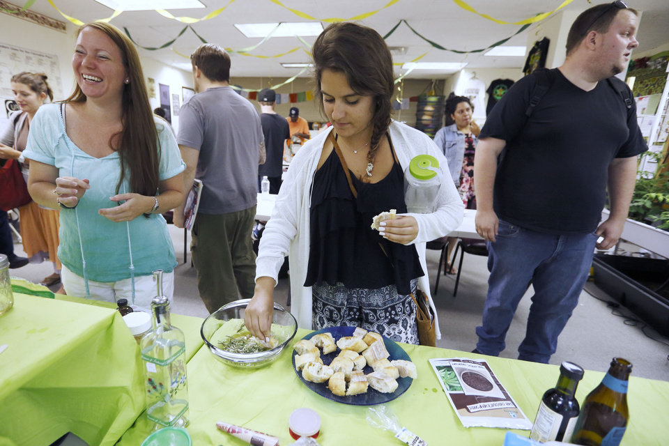 In this Thursday, July 10, 2014, photo, students taste a cannabis-infused dipping sauce prepared during a cooking class at the New England Grass Roots Institute in Quincy, Mass. The proliferation of marijuana edibles for medical and recreational use is giving rise to a cottage industry of foods, infused olive oils, cookbooks and classes as more states legalize marijuana use. (AP Photo/Michael Dwyer)