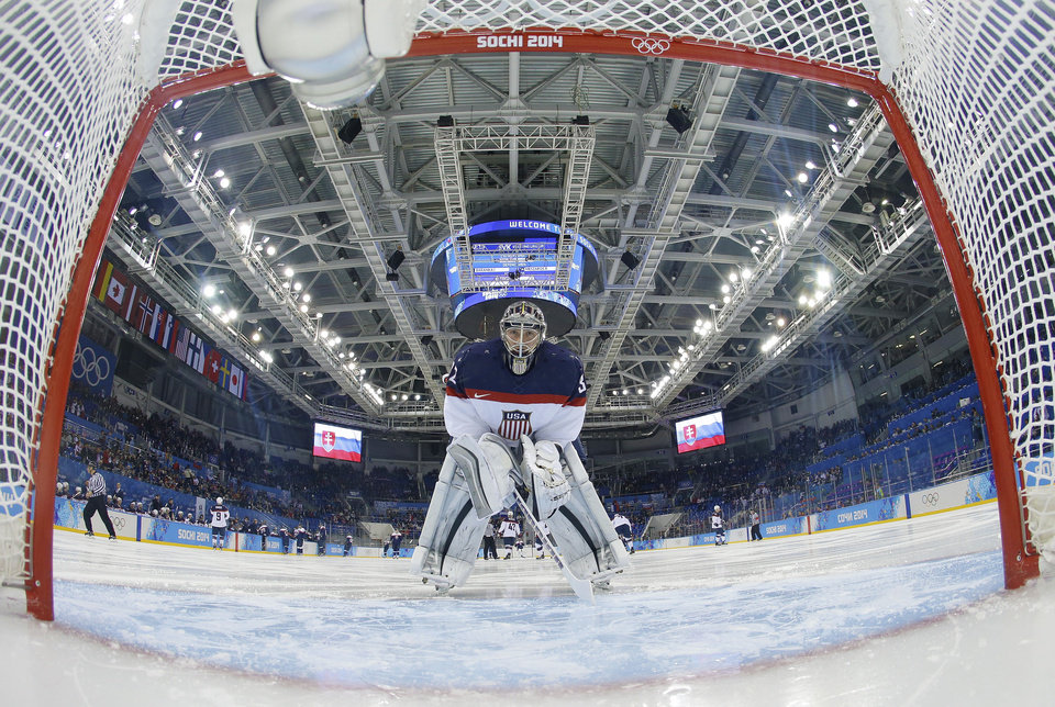 Photo - USA goaltender Jonathan Quick looks back into the net before the game against Slovakia during the men's ice hockey tournament at the 2014 Winter Olympics, Thursday, Feb. 13, 2014, in Sochi, Russia. (AP Photo/Brian Snyder, Pool)