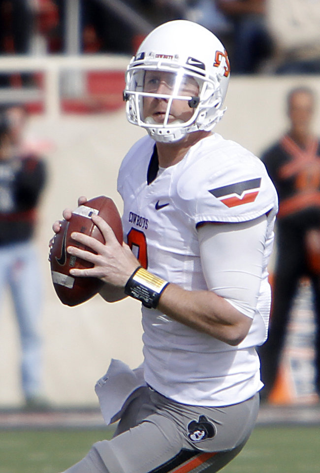 Photo - Oklahoma State Cowboys quarterback Brandon Weeden (3) looks to throw the ball during the college football game between the Oklahoma State University Cowboys (OSU) and Texas Tech University Red Raiders (TTU) at Jones AT&T Stadium on Saturday, Nov. 12, 2011. in Lubbock, Texas.  Photo by Chris Landsberger, The Oklahoman  ORG XMIT: KOD