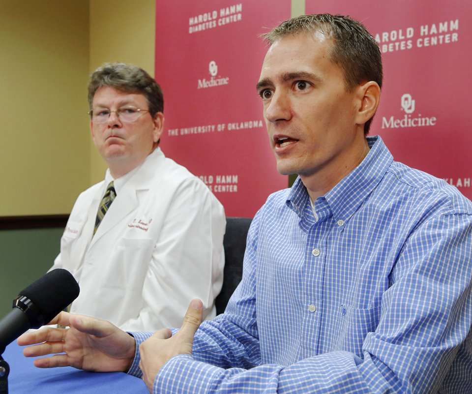 Photo - Dr. James Lane, left, an endocrinologist,  and his patient Nathan Mobley, 35, right, talked about a lesser known type of diabetes called Latent Autoimmune Diabetes in Adults (LADA) at a press conference Tuesday,  July 30, 2013, at the Harold Hamm Diabetes Center at the University of Oklahoma in Oklahoma City. M obey was recently diagnosed with the disease.    Photo  by Jim Beckel, The Oklahoman.