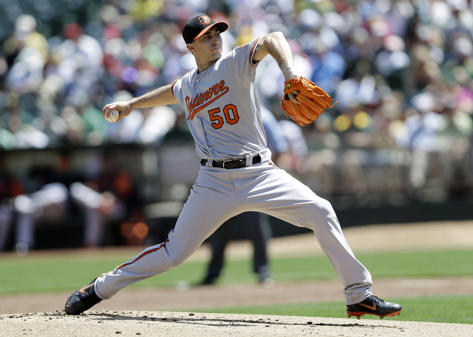 Photo - Baltimore Orioles starting pitcher Miguel Gonzalez throws to the Oakland Athletics during the first inning of a baseball game on Sunday, April 28, 2013, in Oakland. Calif. (AP Photo/Marcio Jose Sanchez)