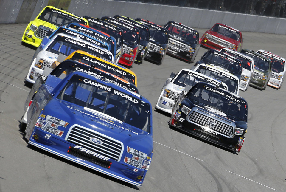 Photo - Ryan Blaney leads the field during the NASCAR Camping World truck series auto race at Michigan International Speedway in Brooklyn, Mich., Saturday, Aug. 16, 2014. (AP Photo/Bob Brodbeck)