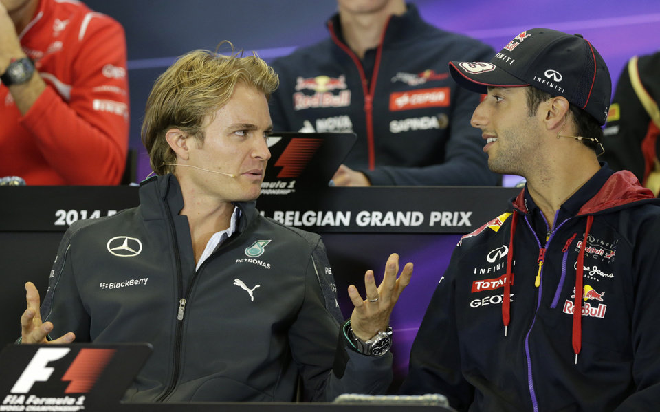 Photo - Red Bull driver Daniel Ricciardo of Australia, right, talks with Mercedes driver Nico Rosberg of Germany during a media conference ahead of Sunday's Belgian Formula One Grand Prix in Spa-Francorchamps, Belgium, Thursday, Aug. 21, 2014. (AP Photo/Yves Logghe)