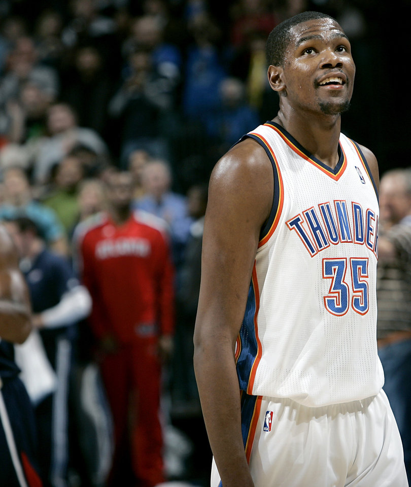 Photo - Oklahoma City's Kevin Durant smiles as the last few seconds tick away against Atlanta during their NBA basketball game at the Oklahoma City Arena in Oklahoma City on Friday, Dec. 31, 2010. The Thunder beat the Hawks 103-94. Photo by John Clanton, The Oklahoman