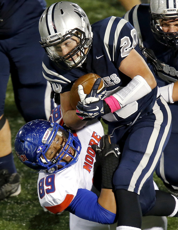 Edmond North's Zack Jenkins runs into a Moore defender (89), not in roster, during their high school football game at Wantland stadium in Edmond, Okla., Thursday, October 24, 2013. Photo by Bryan Terry, The Oklahoman