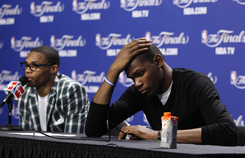 Oklahoma City Thunder point guard Russell Westbrook, left, and small forward Kevin Durant listen to a question during a news conference after Game 4 of the NBA finals basketball series against the Miami Heat, Wednesday, June 20, 2012, in Miami. The Heat won 104-98. (AP Photo/Lynne Sladky) ORG XMIT: NBA201
