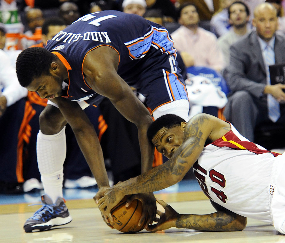 Charlotte Bobcats' Michael Kidd-Gilchrist (14) and Miami Heat's Udonis Haslem (40) scramble for control of the ball during the first half of their NBA basketball game, Wednesday, Dec. 26, 2012, in Charlotte. The Heat won 105-92. (AP Photo/The Charlotte Observer, David T. Foster III) MAGS OUT; TV OUT; NEWSPAPER INTERNET ONLY