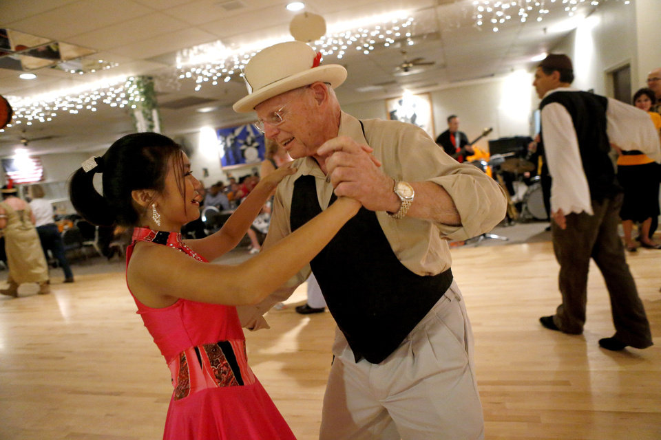 Jerry Dawson dances with Katalina Phomsouvanh, 11, of the Life Change Ballroom Dancers, on Friday, Oct. 19, 2012, during an Oklahoma City Swing Club event. Photo by Bryan Terry, The Oklahoman <strong>BRYAN TERRY - THE OKLAHOMAN</strong>
