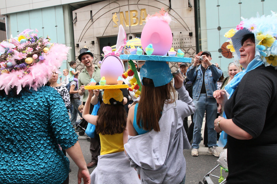 Photo -   Leah, 11, foreground second from left, and her friend Rachel, 10, foreground second from right, both from New Jersey, pose for photographers with others wearing hats as they take part in the Easter Parade along New York's Fifth Avenue Sunday April 24, 2011. (AP Photo/Tina Fineberg)