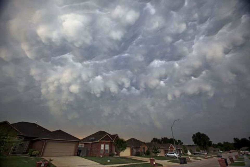 Photo -  Storm clouds build over homes in Yukon, Okla. on Wednesday, May 13, 2009.  Photo by Chris Landsberger, The Oklahoman