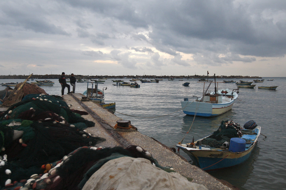 Palestinian fishermen stand at the Gaza seaport, in Gaza City Saturday, Nov. 24, 2012. Gaza residents said Saturday that Israel has eased some border restrictions as part of its truce with the Palestinian territory's Hamas rulers, allowing farmers to visit land near its security fence and letting fishermen head further out to sea. (AP Photo/Adel Hana)