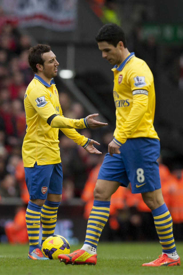 Photo - Arsenal's Santi Cazorla, left, reacts as he stands alongside teammate Mikel Arteta as their team is beaten 5-1 at Liverpool during their English Premier League soccer match at Anfield Stadium, Liverpool, England, Saturday Feb. 8, 2014. (AP Photo/Jon Super)