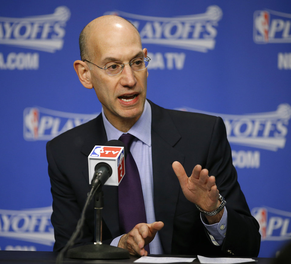 Photo - NBA Commissioner Adam Silver speaks at a news conference before Game 4 in the first round of the NBA playoffs between the Oklahoma City Thunder and the Memphis Grizzlies at FedExForum in Memphis, Tenn., Saturday, April 26, 2014. Photo by Bryan Terry, The Oklahoman