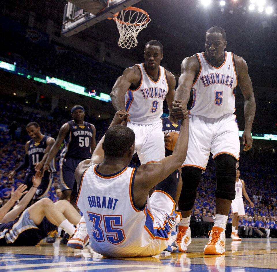 Photo - Oklahoma City's Serge Ibaka (9) and Kendrick Perkins (5) help up Oklahoma City's Kevin Durant (35) during game 7 of the NBA basketball Western Conference semifinals between the Memphis Grizzlies and the Oklahoma City Thunder at the OKC Arena in Oklahoma City, Sunday, May 15, 2011. Photo by Sarah Phipps, The Oklahoman