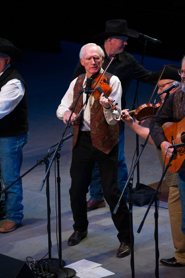 Photo - Bluegrass star Byron Berline performs with his band during a recent concert at the Armstrong Auditorium in Edmond.  PHOTO BY MATT FRIESEN PROVIDED.