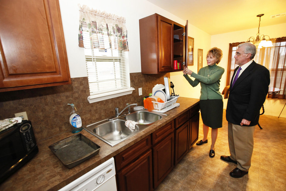 "Ann Felton Gilliland, chairman and CEO of Central Oklahoma Habitat for Humanity, and Dennis Shockley, executive director of the Oklahoma Housing Finance Agency, look over a ""green"" Central Oklahoma Habitat-built house in the Hope Crossing addition at NE 83 and Kelley Avenue. Photos by David McDaniel, The Oklahoman"