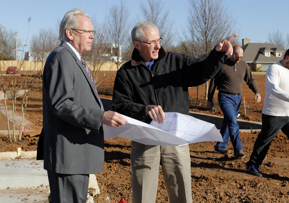 Kelly McNitt, left, one of the developers of Glenbrook Park, looks over the site in Nichols Hills with Huitt-Zollars civil engineer Clyde Wilkens. Photo by PAUL HELLSTERN, The Oklahoman