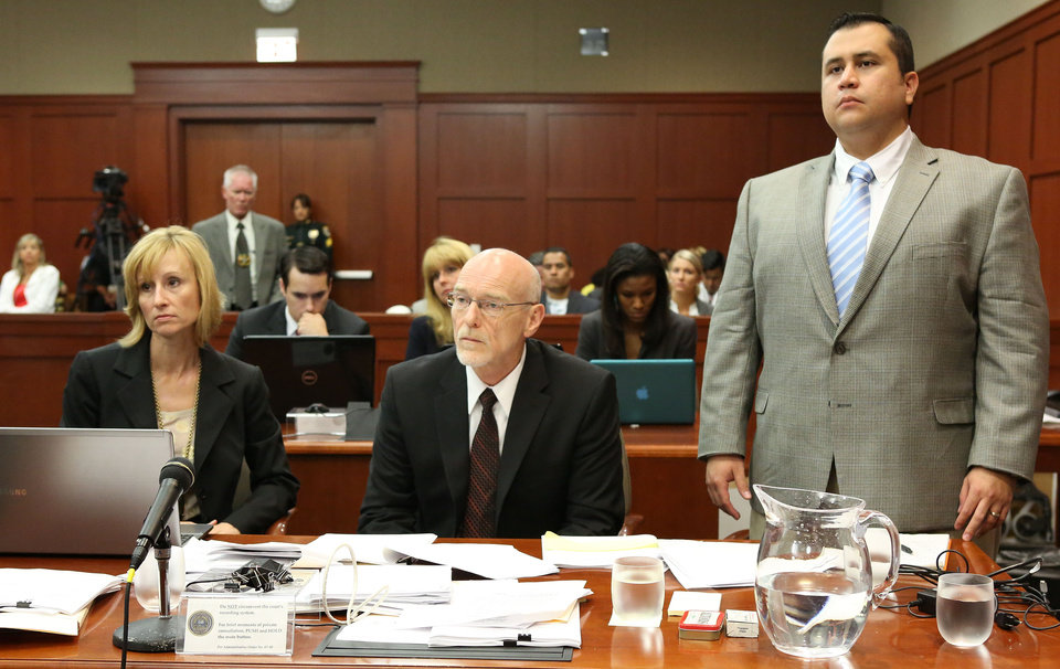Photo - George Zimmerman stands for instructions from Judge Debra Nelson with attorney Lorna Truett, left, and Don West, center, during his trial in Seminole circuit court in Sanford, Fla. Thursday, July 11, 2013. Zimmerman has been charged with second-degree murder for the 2012 shooting death of Trayvon Martin. (AP Photo/Orlando Sentinel, Gary W. Green, Pool)