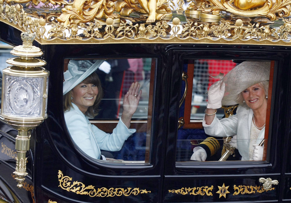 Photo - Carole Middleton, left, mother of Kate Middleton and Camilla, Duchess of Cornwall leave Westminster Abbey, London, following the wedding of Britain's Prince William and Kate Middleton, Friday April 29, 2011. (AP Photo/Tim Hales) ORG XMIT: LTS120