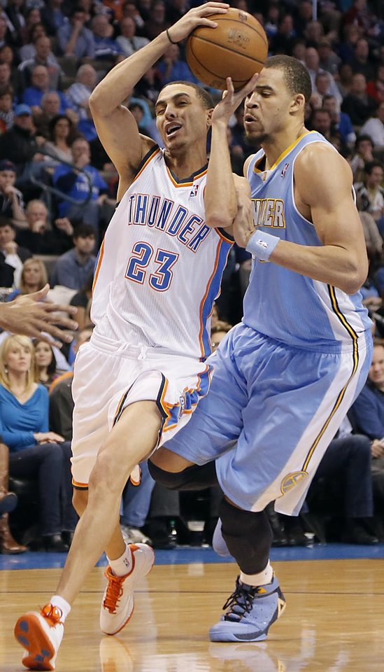 Photo - Oklahoma City's Kevin Martin (23) drives past Denver's JaVale McGee (34) during the NBA basketball game between the Oklahoma City Thunder and the Denver Nuggets at the Chesapeake Energy Arena on Wednesday, Jan. 16, 2013, in Oklahoma City, Okla.  Photo by Chris Landsberger, The Oklahoman