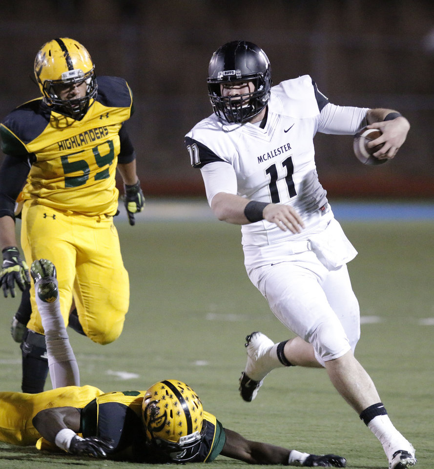 Photo - MHS #11 Dalton Wood eludes defenders during the high school football playoff between McAlester and Lawton MacArthur at Choctaw stadium, November 28, 2014. Photo by Doug Hoke, The Oklahoman
