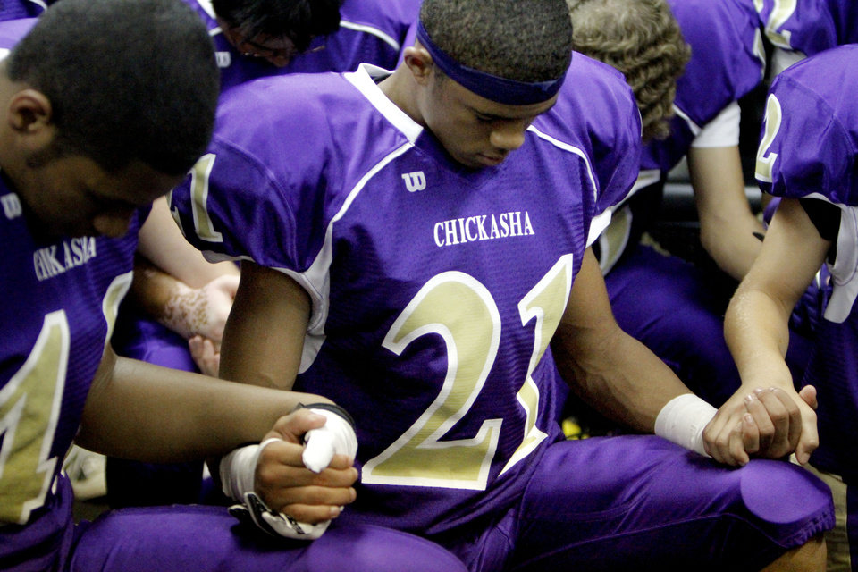 Daniel Neff prays before the football game between Chickasha and Capitol Hill at Chickasha High School, Friday, Oct. 1, 2010.  It was the first home game since the death of player Kody Turner. Photo by Sarah Phipps, The Oklahoman