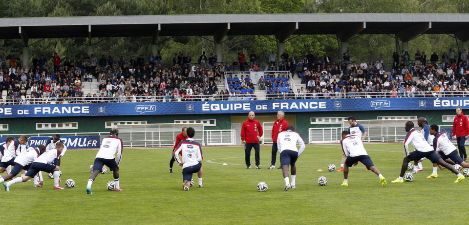 Photo - France's soccer players stretch, during a training session at the Clairefontaine training center, outside Paris, Thursday, May 29, 2014. France are preparing for the upcoming soccer World Cup in Brazil starting on 12 June. (AP Photo/Christophe Ena)