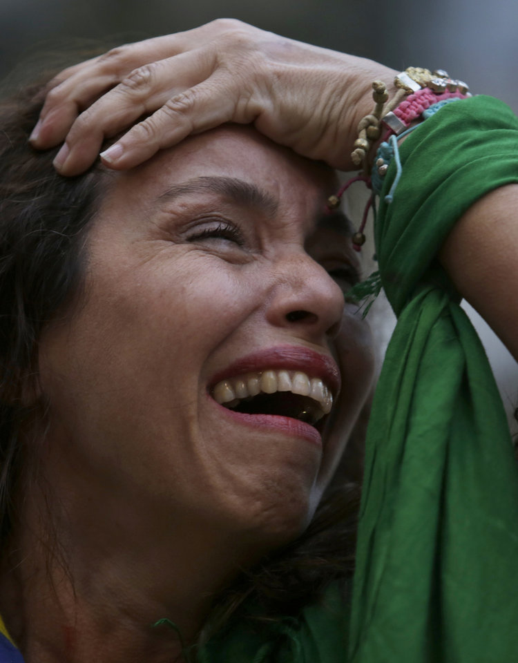 Photo - RETRANSMITTING FOR IMPROVED QUALITY.- A Brazil soccer fan cries as she watches Germany defeat her team in a World Cup semifinal match, via a live telecast in Belo Horizonte, Brazil, Tuesday, July 8, 2014. The tears started flowing before half time, and by the end of a 7-1 shellacking in the World Cup semifinal, millions across Brazil were in dazed, damp-eyed disbelief. (AP Photo/Bruno Magalhaes)