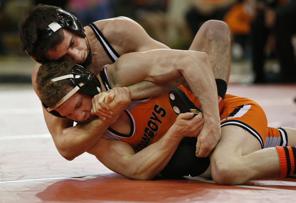 Photo - Oklahoma's Jarrod Patterson takes on Oklahoma State's Eddie Klimara at 125 pounds during the 2014 Big 12 Wrestling Championship finals at the University of Oklahoma in McCasland Field House on March 8, 2014 in Norman, Okla. Photo by Steve Sisney, The Oklahoman