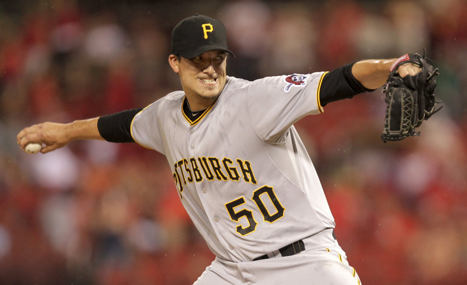 Photo - Pittsburgh Pirates starting pitcher Charlie Morton (50) sets to deliver a pitch in the first inning of a baseball game against the St. Louis Cardinals, Monday, July 7, 2014 in St. Louis. (AP Photo/Tom Gannam)