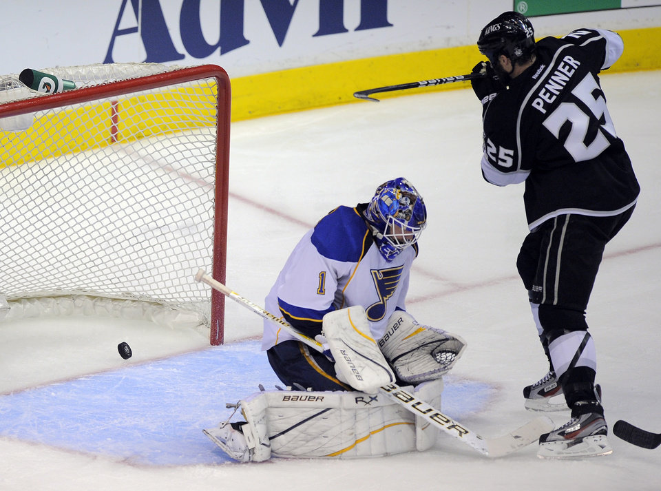 Photo -   Los Angeles Kings left wing Dustin Penner, right, celebrates a goal by defenseman Drew Doughty as St. Louis Blues goalie Brian Elliott looks on during the third period in Game 3 of an NHL hockey Stanley Cup second-round playoff series, Thursday, May 3, 2012, in Los Angeles. The Kings won 4-2. (AP Photo/Mark J. Terrill)