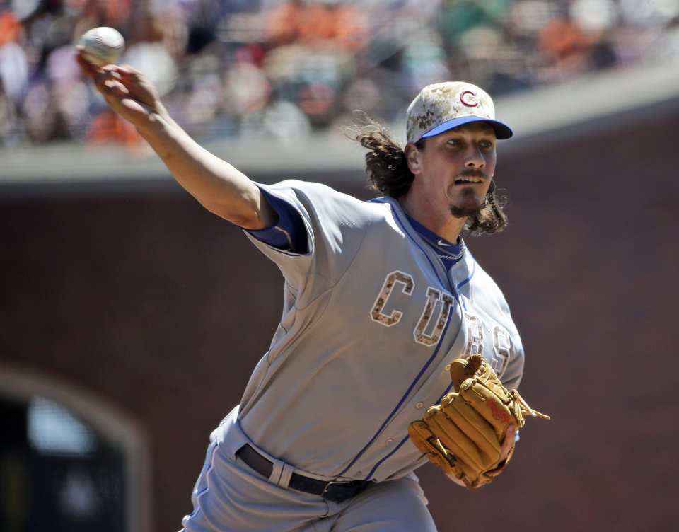 Chicago Cubs starting pitcher Jeff Samardzija throws to the San Francisco Giants during the first inning of a baseball game on Monday, May 26, 2014, in San Francisco. (AP Photo/Marcio Jose Sanchez)