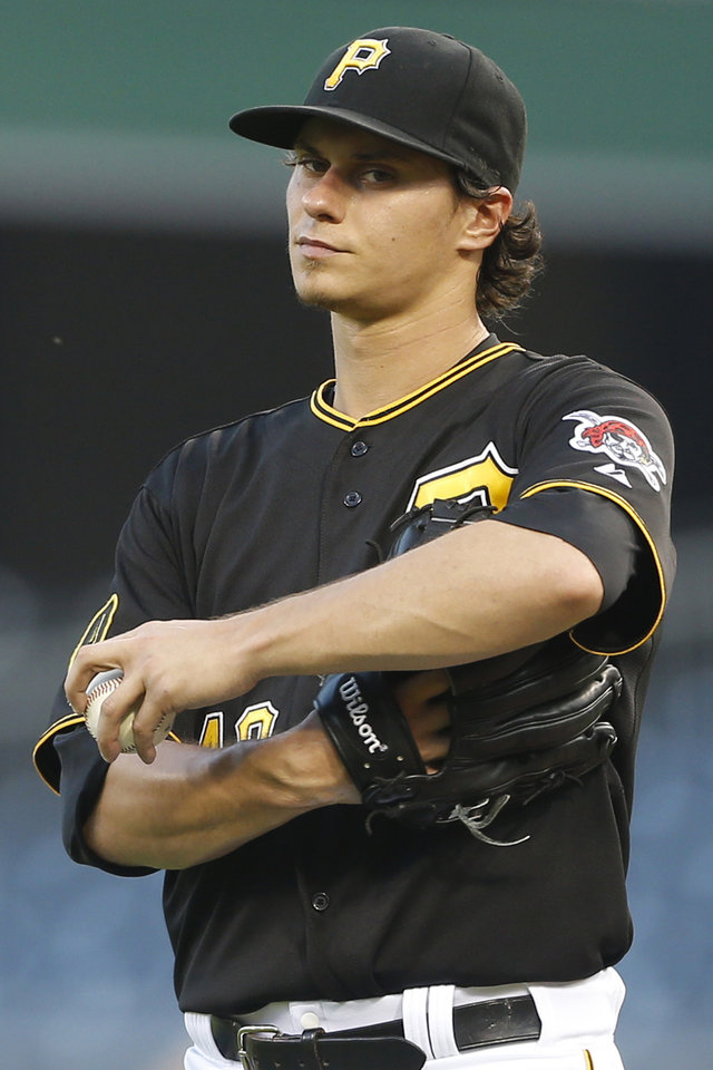 Photo - Pittsburgh Pirates starting pitcher Jeff Locke reacts after giving up a second run to the Arizona Diamondbacks in the fifth inning of the baseball game on Tuesday, July 1, 2014, in Pittsburgh. (AP Photo/Keith Srakocic)