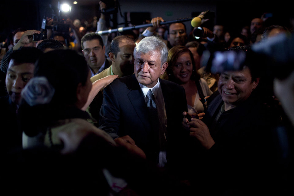 "Photo -   Mexican presidential candidate Andres Manuel Lopez Obrador of the Democratic Revolution Party (PRD), leaves a hotel after a press conference in Mexico City, Monday, July 2, 2012. After official results showed Enrique Pena Nieto of the Institutional Revolutionary Party (PRI) winning 38 per cent of the vote with more than 92 per cent of the votes counted, Lopez Obrador has not conceded Sunday's elections, telling his supporters Monday evening that, ""We can't accept a fraudulent result,"" a reference to his allegations that Pena Nieto exceeded campaign spending limits, bought votes in some states and benefited from favorable coverage in Mexico's semi-monopolized television industry.(AP Photo/Alexandre Meneghini)"