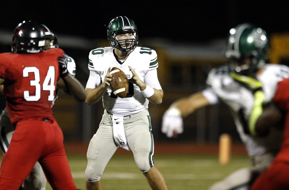 Photo - Norman North's David Cornwell looks to pass during the high school football game between Norman North and Del City at Del City, Okla., Friday, Sept. 13, 2013. Photo by Sarah Phipps, The Oklahoman