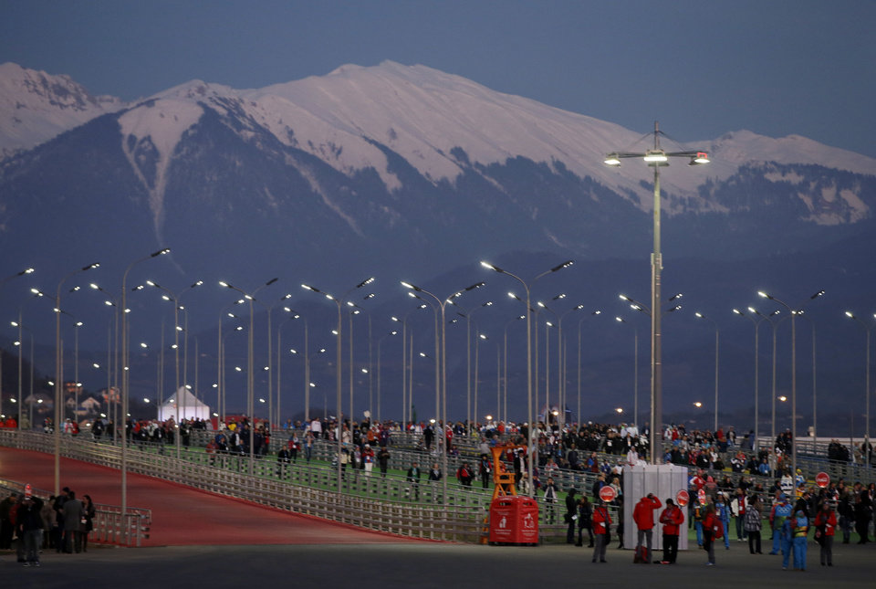 Photo - Fans make their way to Fisht Stadium for the opening ceremony of the 2014 Winter Olympics in Sochi, Russia, Friday, Feb. 7, 2014. (AP Photo/Darron Cummings)