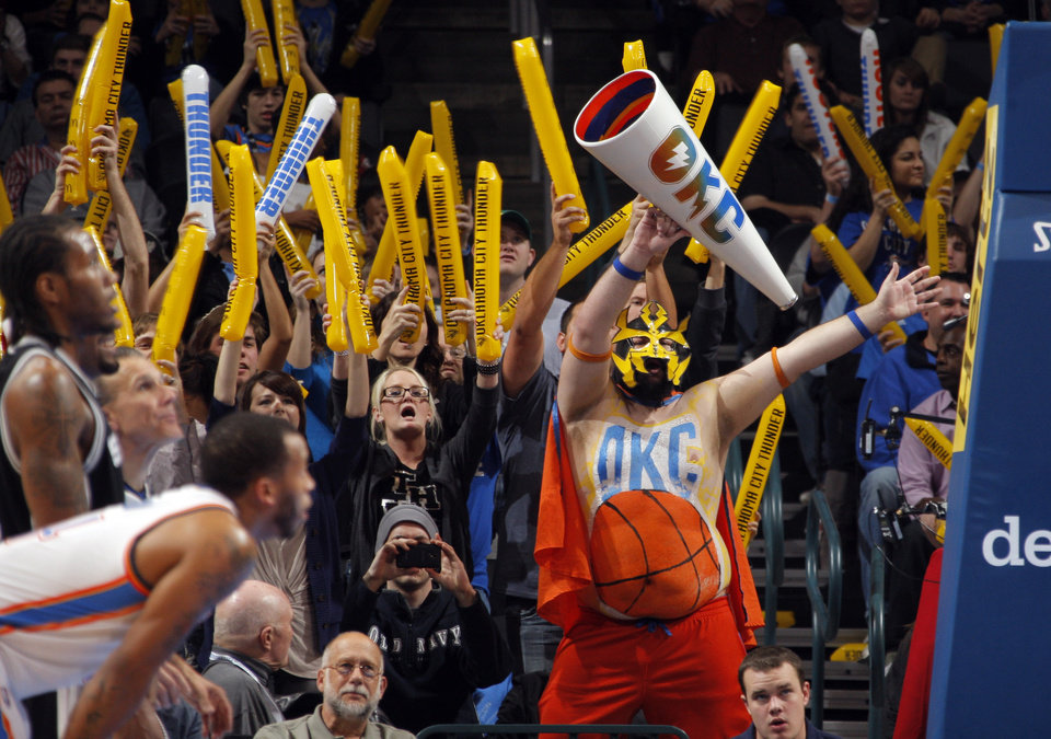 Photo - Oklahoma City fans try to distract San Antonio players during the the NBA basketball game between the Oklahoma City Thunder and the San Antonio Spurs at the Chesapeake Energy Arena in Oklahoma City, Sunday, Jan. 8, 2012. Photo by Sarah Phipps, The Oklahoman