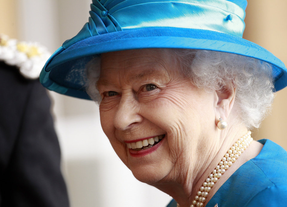 Photo - Britain's Queen Elizabeth smiles to the media as she arrives at Hillsborough Castle, Northern Ireland, Monday, June, 23, 2014. The Queen and the Duke of Edinburgh arrived in Northern Ireland for the beginning of a three-day visit. (AP Photo/Peter Morrison)