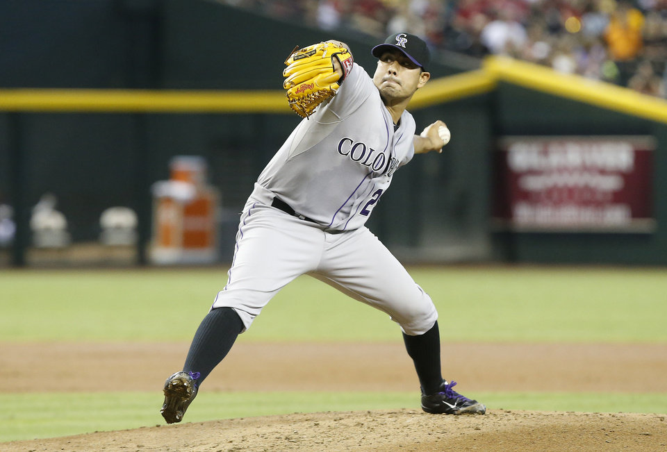 Photo - Colorado Rockies' Jorge De La Rosa delivers a pitch against the Arizona Diamondbacks in the first inning of a baseball game, Saturday, Aug. 9, 2014, in Phoenix. (AP Photo/Darryl Webb)