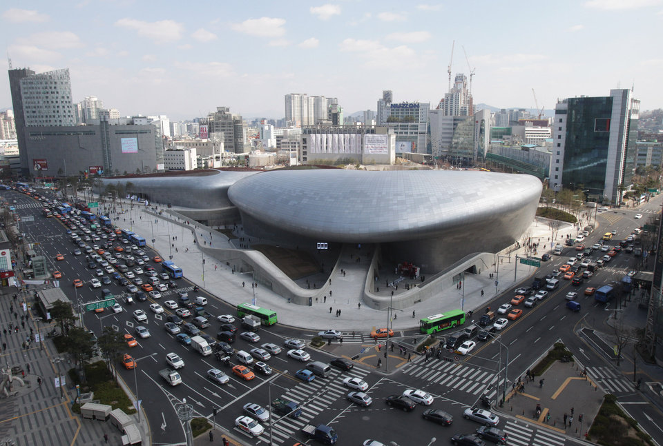 Dongdaemun Design Plaza is seen in downtown Seoul, South Korea, Friday, March 21, 2014. The $450 million building funded by Seoul citizen\'s tax money finally opened to public on Friday after years of debates about transforming a historic area with an ultra-modern architecture. (AP Photo/Ahn Young-joon)