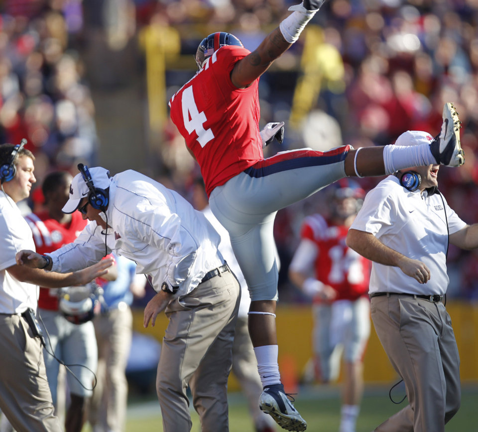 Mississippi linebacker Denzel Nkemdiche (4) celebrates with special teams coach Tom Allen after a failed field goal attempt by LSU in the first half of an NCAA college football game in Baton Rouge, La., Saturday, Nov. 17, 2012. (AP Photo/Gerald Herbert)